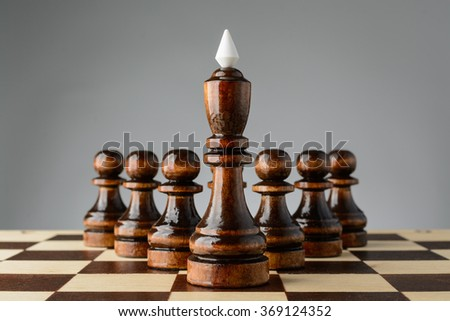 Black king and pawns on the chessboard