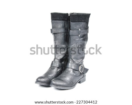 Black knee high boots with suede and buckles. Angle view