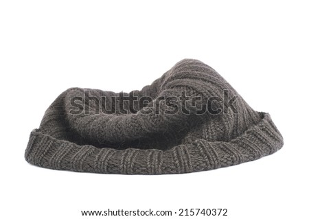 Black knitted head cap isolated over the white background