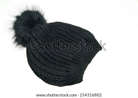 Black Knitted Wool Winter Ski Hat with Pom Pom Isolated On White Background - stock photo