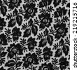Black lace fabric texture with floral design. - stock photo