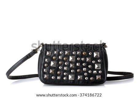 black ladies handbag with iron accents on a white isolated background