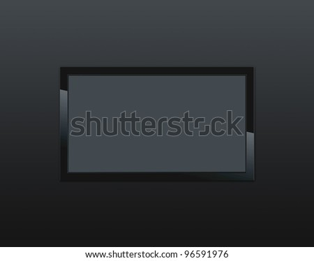 Black LCD tv screen hanging on a wall - stock photo