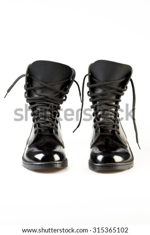 Black Leather Army Boots on white background - stock photo