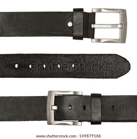 black leather belts with silver buckle are isolated on a white background - stock photo