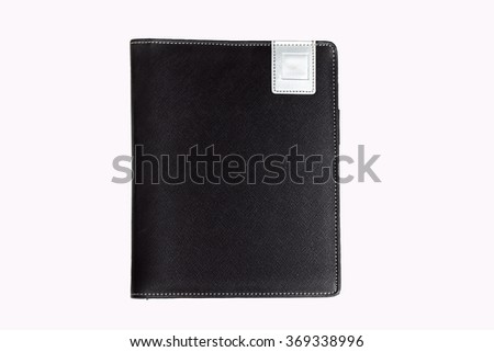 Black leather book on white background. - stock photo