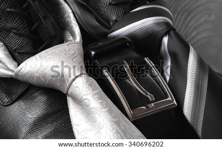 black leather boot strap and tie on a natural background