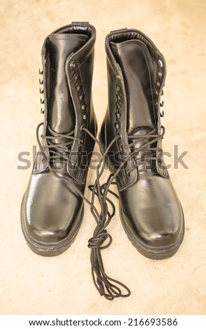 Black Leather Boots on blare cement floor    - stock photo