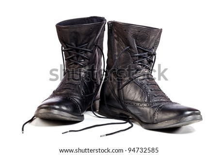 black leather boots on white background