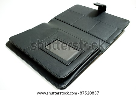 Black leather case of notebook isolated on white background - stock photo