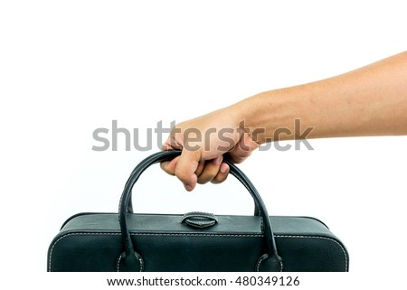 Black leather handbag in hand isolate on white background