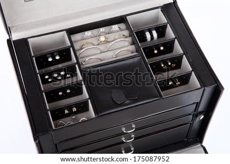 Black leather jewelery box with jewelry inside - stock photo