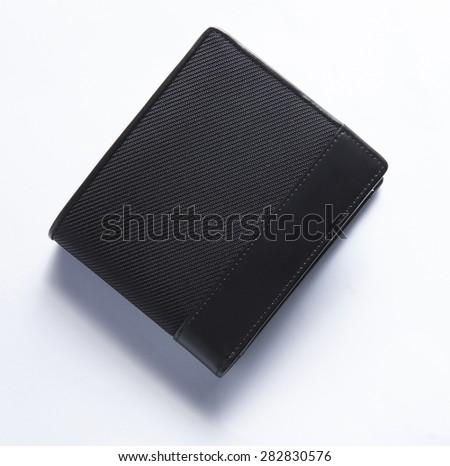 black leather men wallet with shadows isolated in white background - stock photo