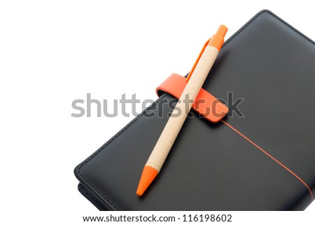 Black leather notebook and pen isolated on white - stock photo