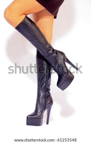Black leather platform boots with high heels - stock photo