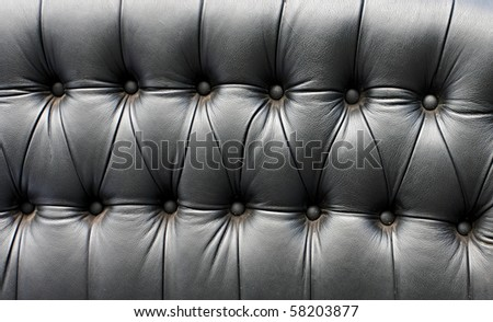 Black leather seat in an old car (close-up) - stock photo