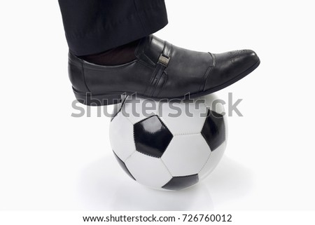 Black leather shoe step on ball