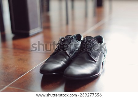 black leather shoes on floor - stock photo