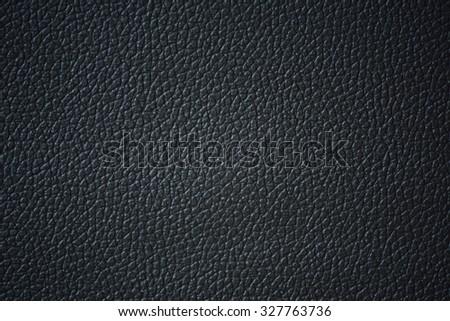 Black leather texture closeup. - stock photo