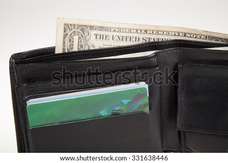 black leather wallet with money inside