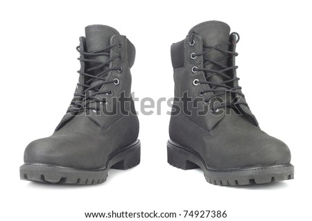 Black leather winter footwear isolated over white background