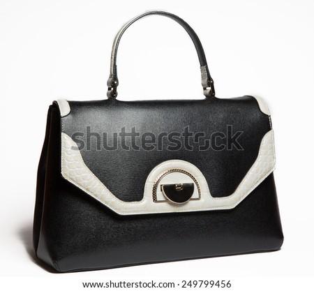 Black leather woman handbag with white elements on white background - stock photo