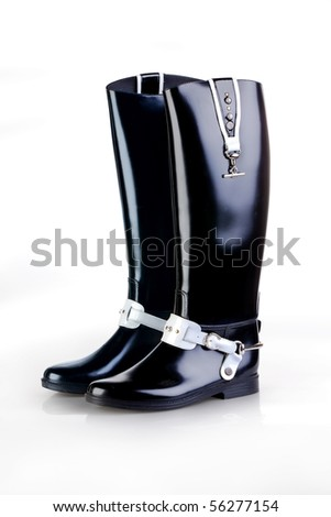 Black leather women's boots on a white background - stock photo