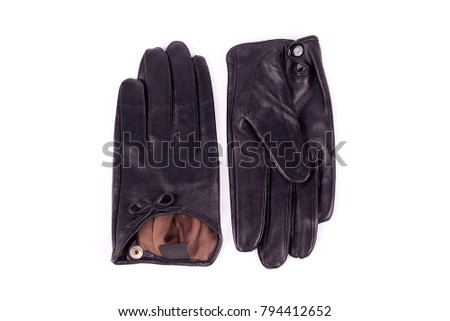 Black leather women's gloves isolated on white background