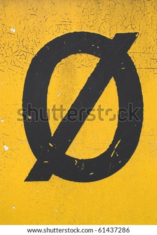 Black letter Ã? on yellow grungy background - stock photo