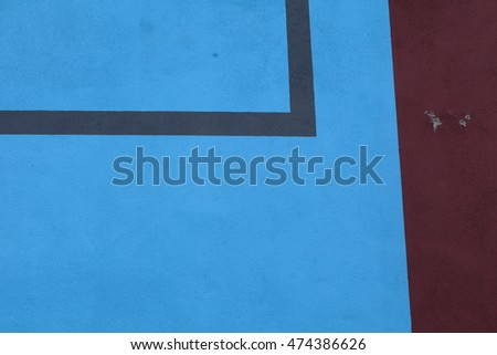 Black lines in blue and red on a painted wall