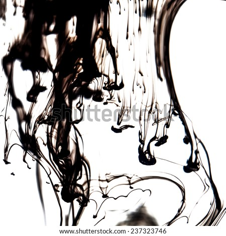 Black liquid in water making abstract forms - stock photo