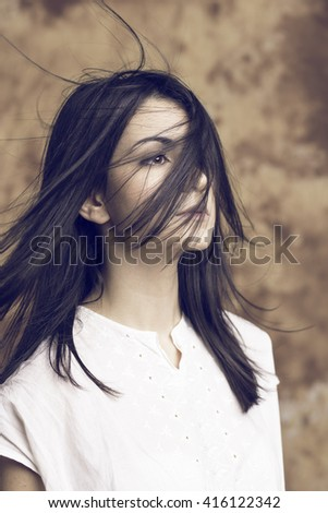 black long hair model portrait with wind