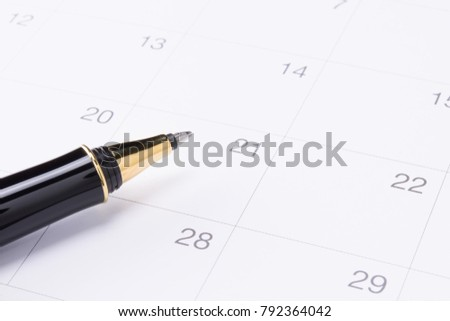 black luxury pen on calendar, business planning concept