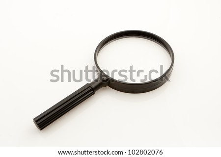 black magnifying glass on white seamless - stock photo