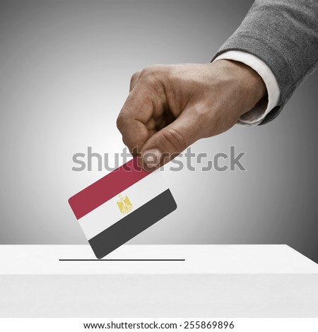 Black male holding flag. Voting concept - Arab Republic of Egypt - stock photo