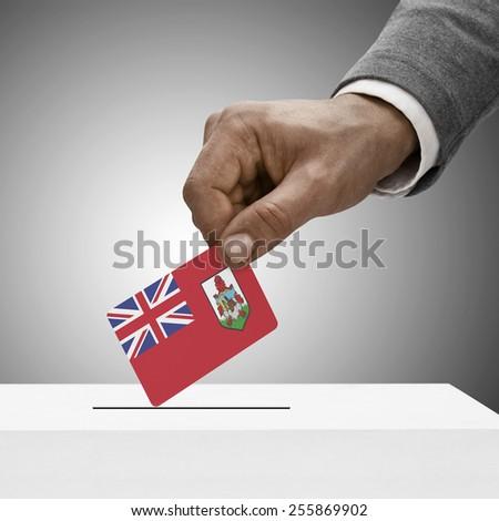 Black male holding flag. Voting concept - Bermuda - stock photo