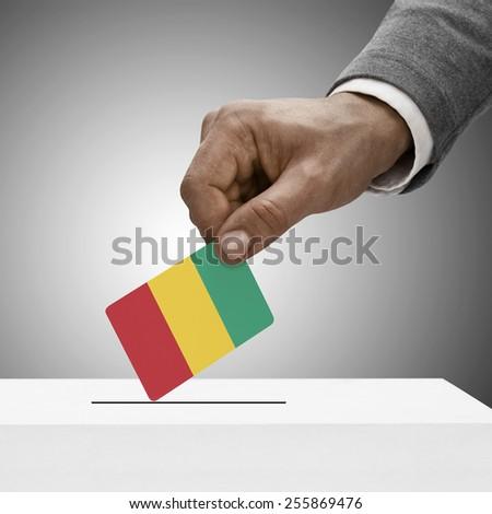 Black male holding flag. Voting concept - Guinea - stock photo