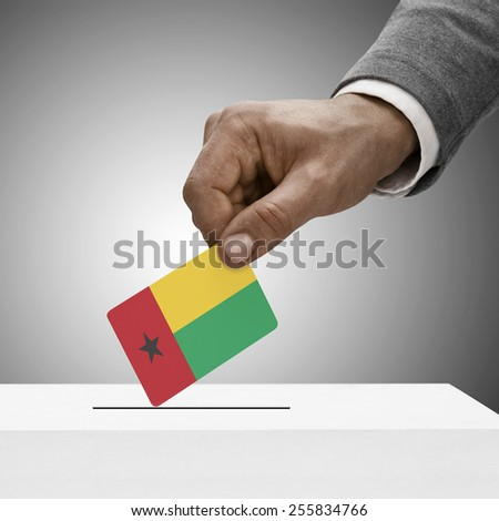 Black male holding flag. Voting concept - Guinea-Bissau - stock photo