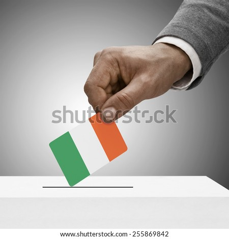 Black male holding flag. Voting concept - Ireland - stock photo