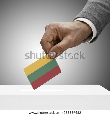 Black male holding flag. Voting concept - Lithuania - stock photo