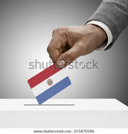Black male holding flag. Voting concept - Paraguay - stock photo