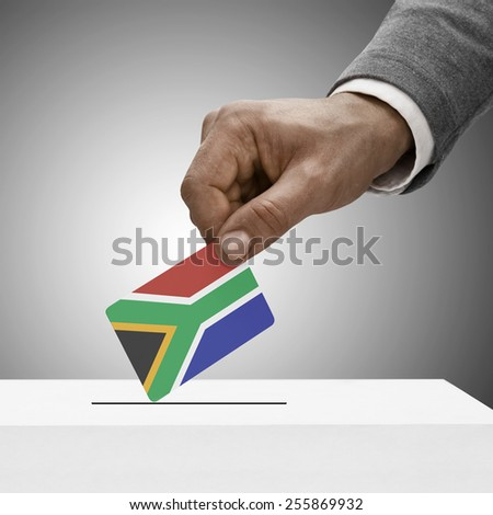 Black male holding flag. Voting concept - Republic of South Africa - stock photo