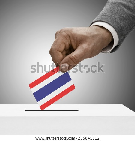 Black male holding flag. Voting concept - Thailand - stock photo