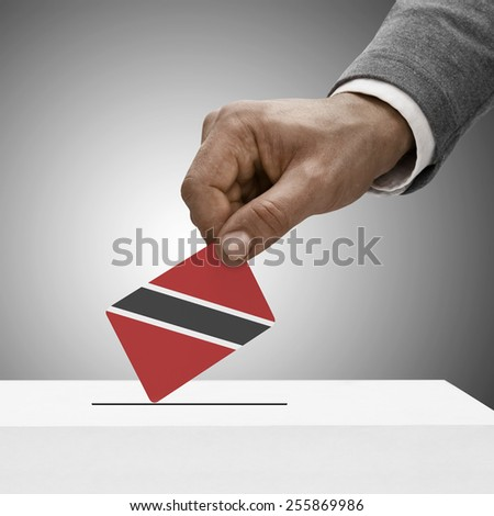 Black male holding flag. Voting concept - Trinidad and Tobago - stock photo