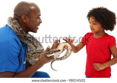 Black Male Vet Holding Snake While A Young Child Looks On - stock photo