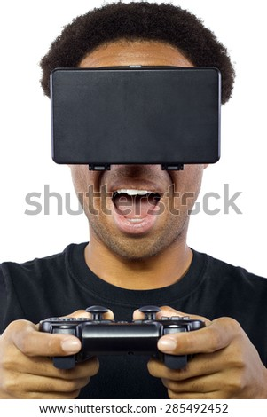 Black male wearing a virtual reality headset and holding a controller on white background.  He is wearing the device as goggles over his eyes.