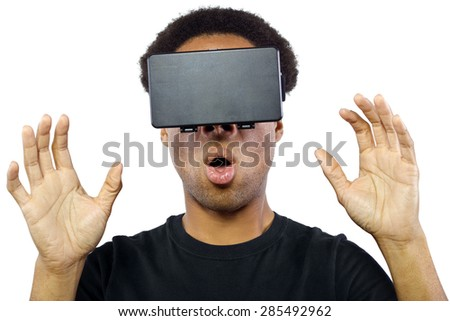 Black male wearing a virtual reality headset on a white background - stock photo