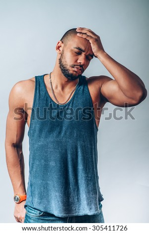 black man has headache - stock photo