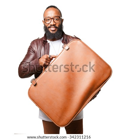 black man holding a leather bag - stock photo