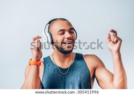 black man listening to music on headphones - stock photo